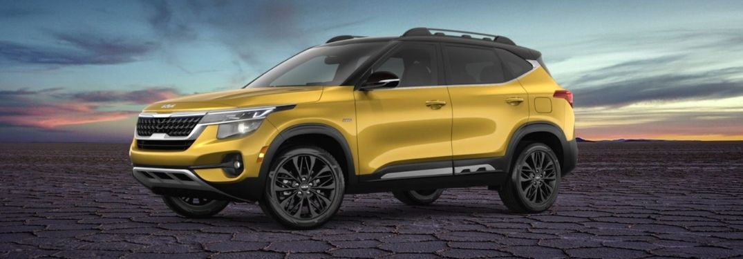Image of a yellow 2022 Kia Seltos Nightfall Edition on a rugged terrain with beautiful sky in the background