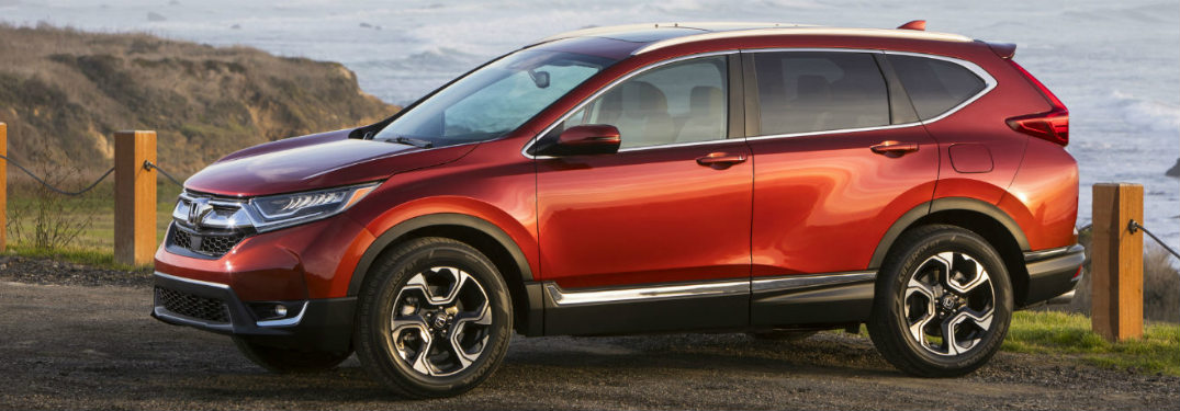 2018 Honda CR-V side view red by water