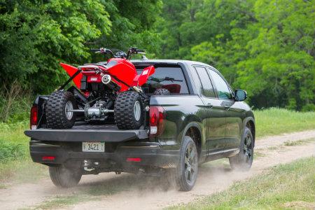 2018 Honda Ridgeline with ATV in the back