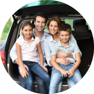 Family Sitting on the Tailgate of a Vehicle