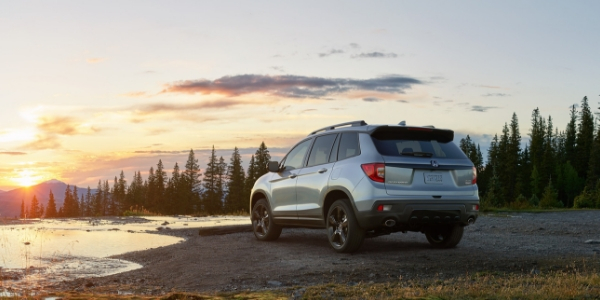 Silver 2019 Honda Passport Rear Exterior at Sunset by the Lake