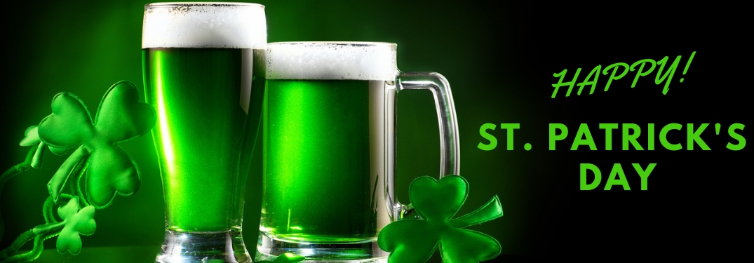 Green Beer and Shamrocks on Black Background with Green Happy St. Patrick's Day Text
