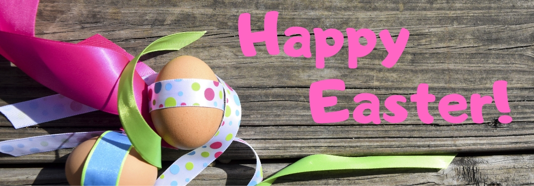Easter Eggs and Ribbon on a Wood Background with Pink Happy Easter! Text