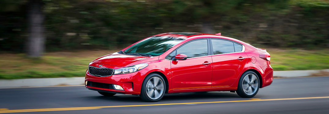 2018 kis forte in red exterior driving on road