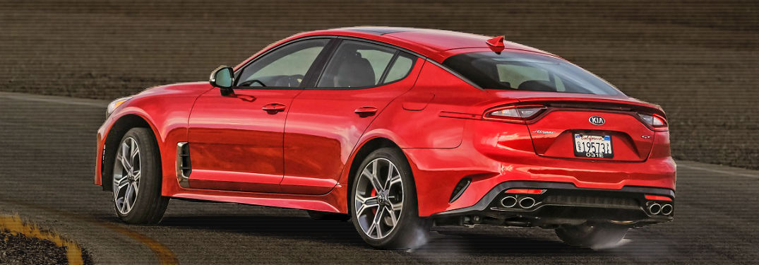 2018 kia stinger in red cruising around a track
