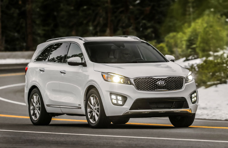 White 2018 Kia Sorento Driving On City Roads
