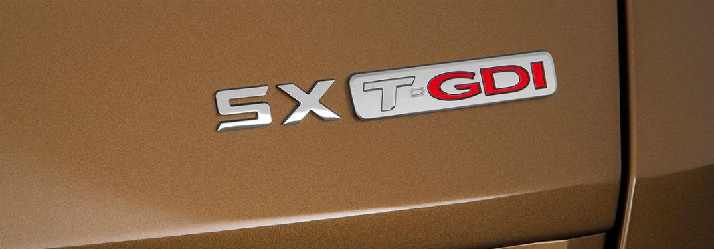 closeup photo of SX Turbo badge on 2019 Kia Sportage