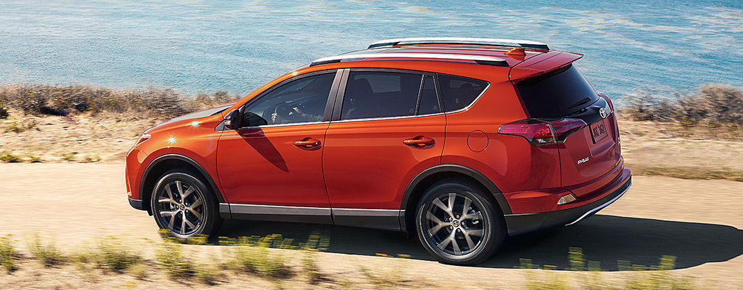 New 2016 Toyota RAV4 SE Trim Features at Downeast Toyota-Bangor ME-Hot Lava 2016 Toyota RAV4 SE On the Road