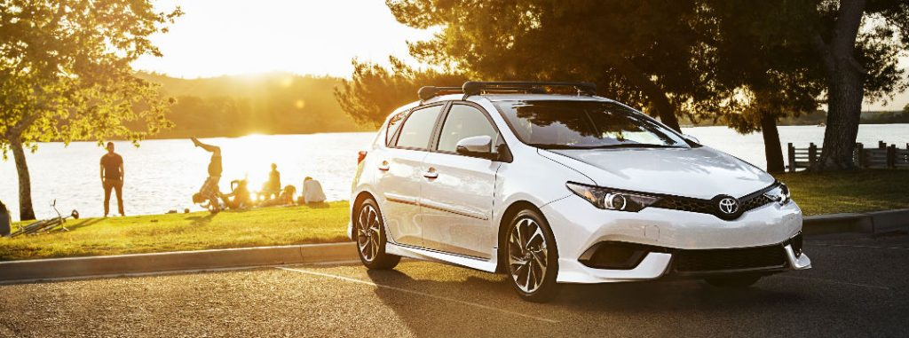 White 2017 Toyota Corolla iM and Family at the Park at Sunset