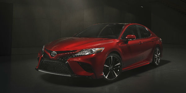 Red 2018 Toyota Camry XSE Front and Side Exterior in Dark Warehouse