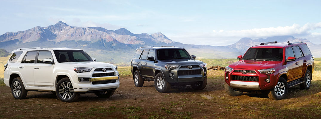 White 2017 Toyota 4Runner Limited, Bklue 2017 Toyota 4Runner SR5 and Red 2017 Toyota 4Runner TRD Off-Road in front of mountains
