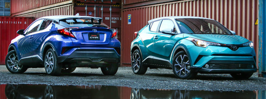 Blue and Green 2018 Toyota C-HR Models in Shipping Yard next to water