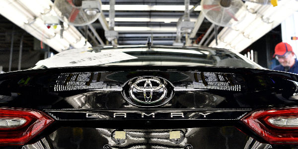 Rear of Black 2018 Toyota Camry on Assembly Line