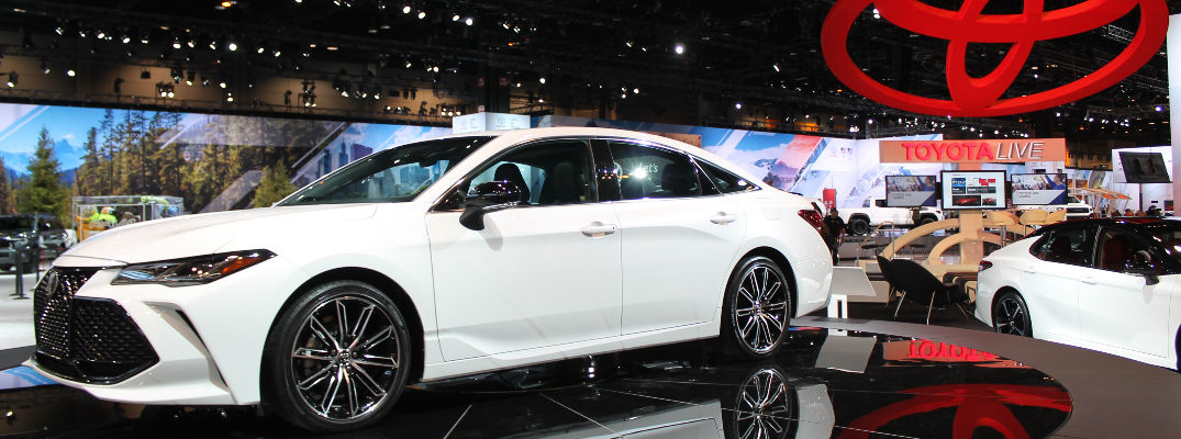 White 2019 Toyota Avalon on Stage at Chicago Auto Show with Toyota Display in the Background