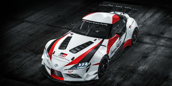 Overhead View of Red, White and Black Toyota GR Supra Concept on Black Asphalt