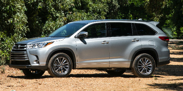 Silver 2018 Toyota Highlander on Dirt Road in Forest