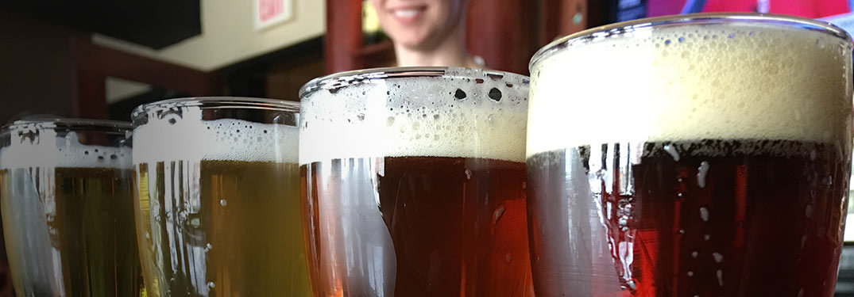 Close Up of Full Pint Glasses on a Bar