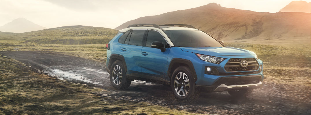 Blue 2019 Toyota RAV4 with AWD in the Mud