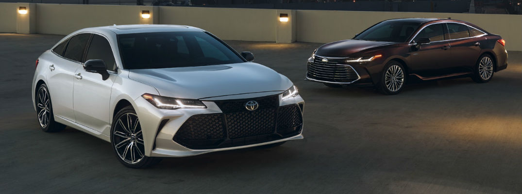 White and Amber 2019 Toyota Avalon Models Parked in a Parking Structure