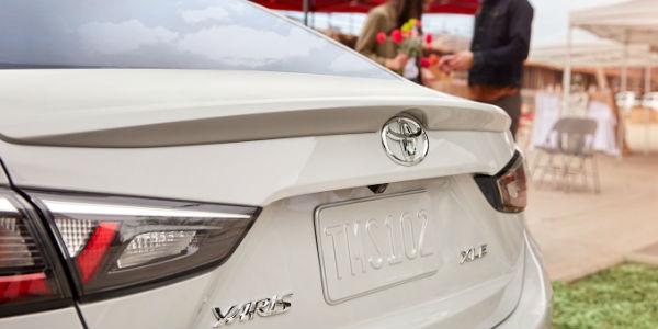 Close Up of White 2019 Toyota Yaris Sedan XLE Rear Exterior
