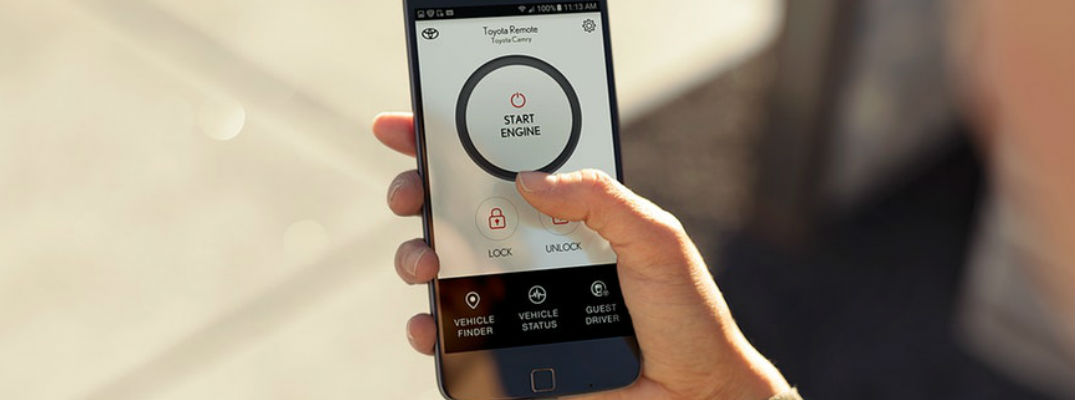 Close Up of Hand Holding a Smartphone with the Toyota Entune 3.0 Remote Connect App