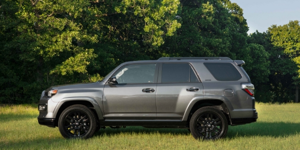 Gray 2019 Toyota 4Runner Nightshade Edition Side Exterior in Grass Field