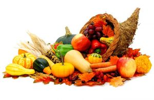Thanksgiving Cornucopia with Fall Vegetables on a White Background
