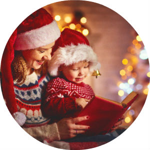 Mother Reading a Book to Son on Christmas with Santa Hats On