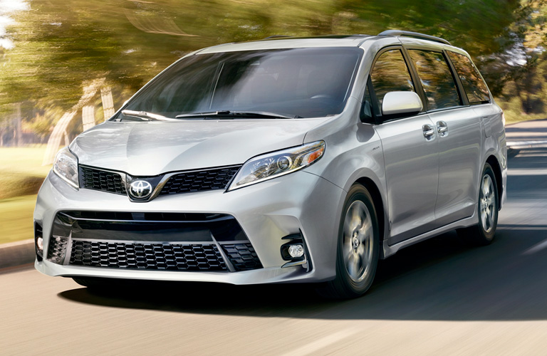 Silver 2019 Toyota Sienna on a City Street