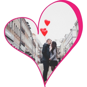 Pink Heart Outline with Couple Kissing on a City Street with Red Heart Balloons