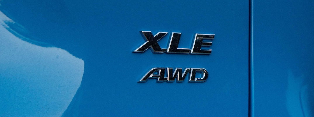 Close Up of 2019 Toyota RAV4 XLE AWD Badge on Blue Exterior