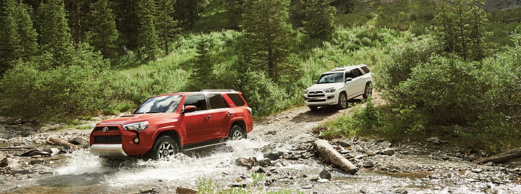 Red and White 2019 Toyota 4Runner Models Fording a Stream