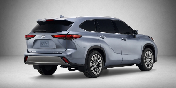 Blue 2020 Toyota Highlander Rear Exterior on Gray Background