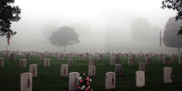Military Cemetery with Headstones and Fog
