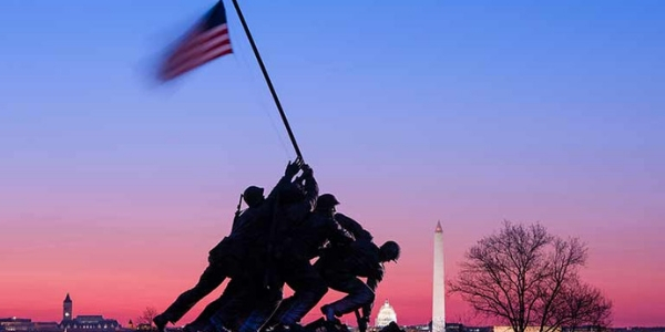 Marine Corps Memorial with American Flag at Sunset in Washington DC