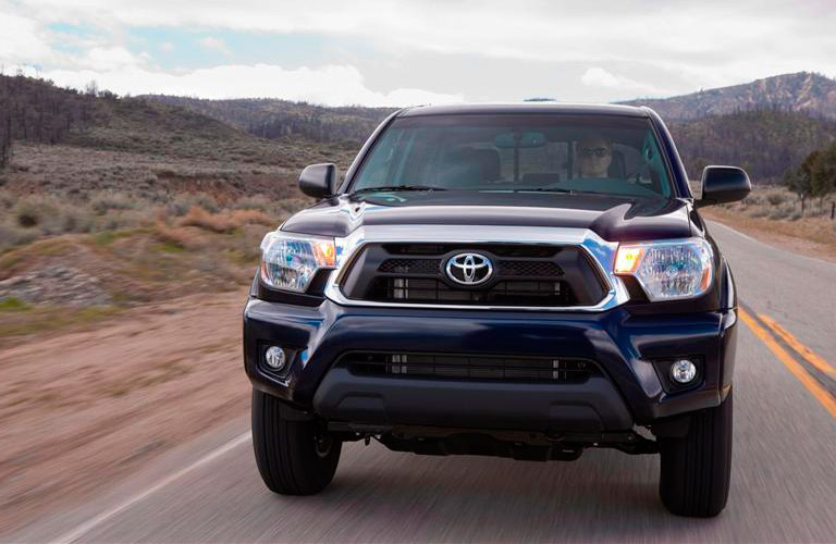 Blue 2013 Toyota Tacoma Front Exterior on Desert Highway