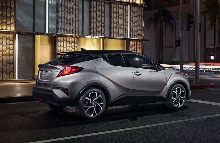 Silver 2019 Toyota C-HR Rear Exterior on a City Street at Night
