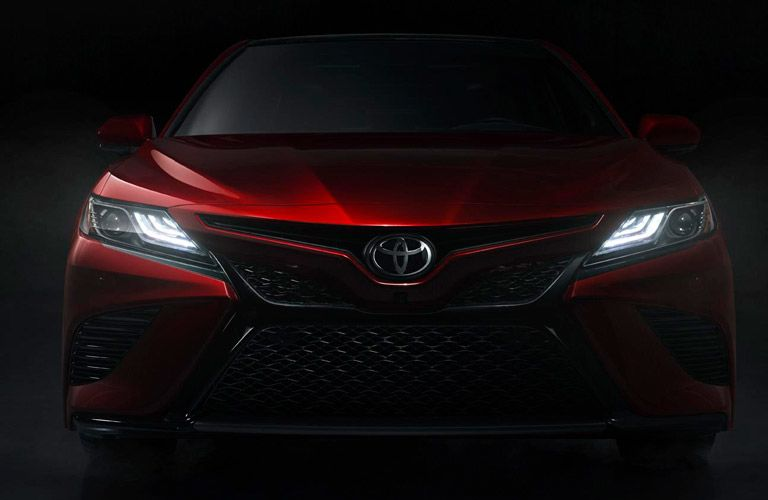 Red 2019 Toyota Camry Grille with Headlights on in Dark