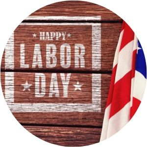 American Flag on Wood Background with White Happy Labor Day Text