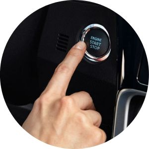 Close Up of Finger Using Push-Button Start in a Toyota Camry