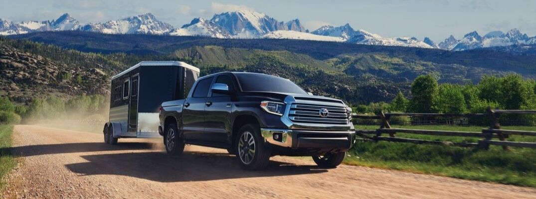 Black 2020 Toyota Tundra Towing a Trailer with Mountains in the Background