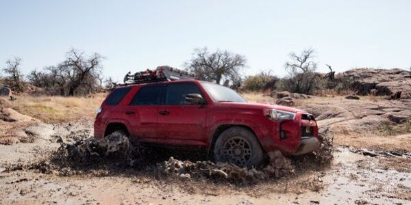 Red 2020 Toyota 4Runner Venture Edition Side Exterior in Mud
