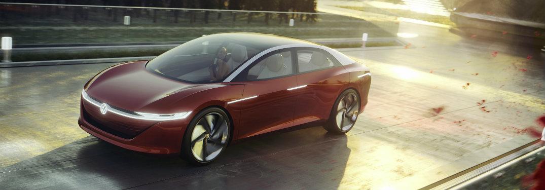 red-Volkswagen-I.D.-VIZZION-concept-driving-over-bridge