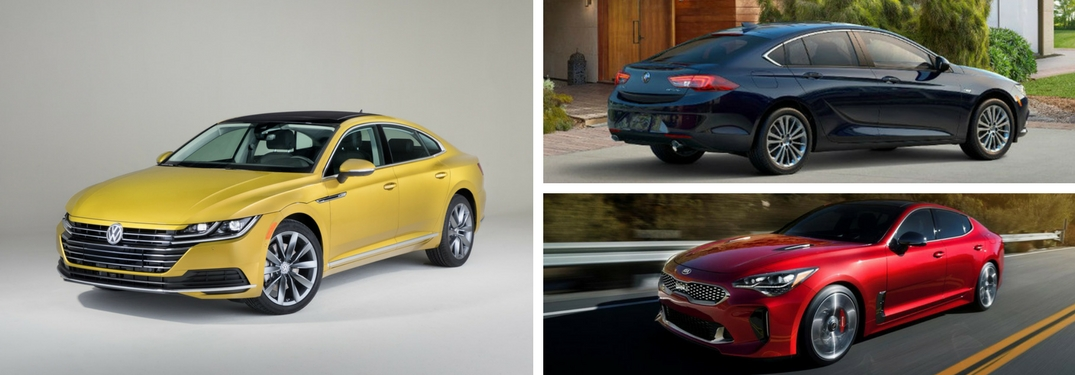 yellow-2019-Volkswagen-Arteon-set-against-Buick-Regal-Sportback-and-Kia-Stinger