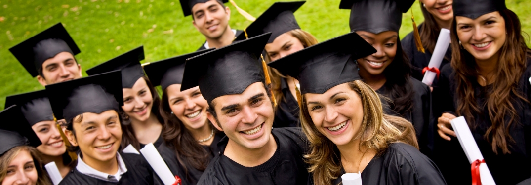 group of college graduates smiling