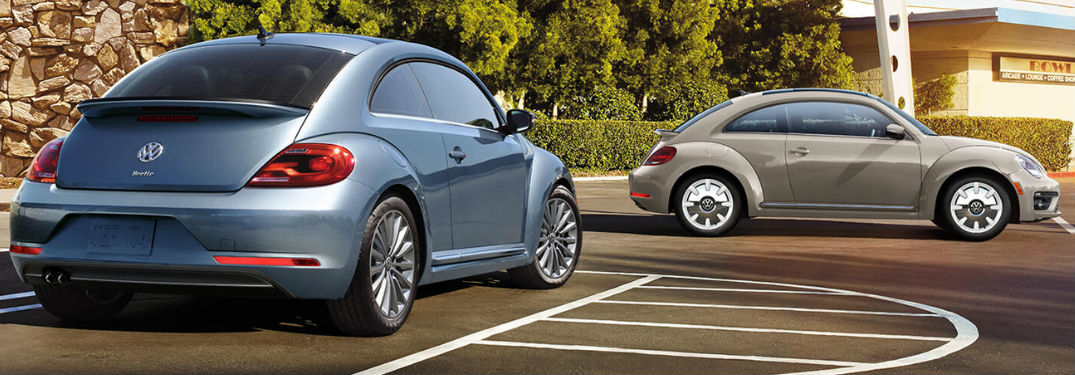 Two 2019 Volkswagen Beetle car parked by each other