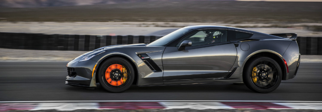 2015 Chevy Corvette Z06 on a track with glowing brakes