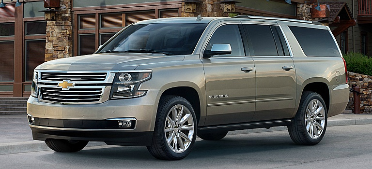 2018 Chevy Suburban gold front side view