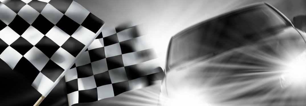 car headlights and checkered flags