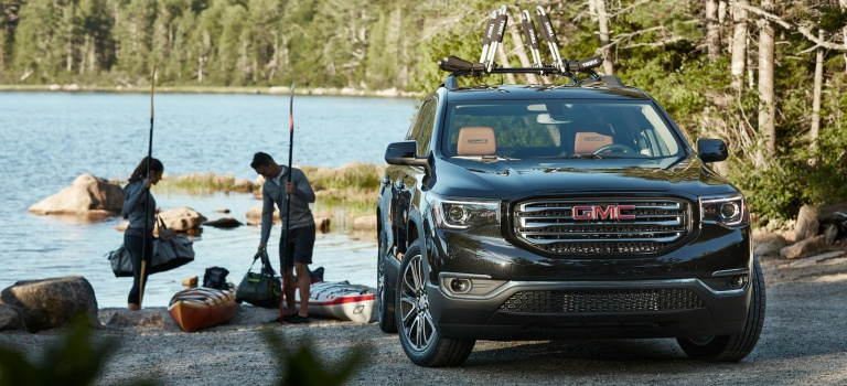 2018 GMC Acadia black front view at the beach